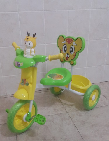 Yellow and Green Tricycle Bike